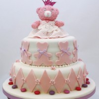 Christening cake with teddy sat on top