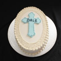 christening cake with blue cross on top
