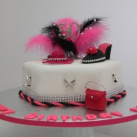 ladies birthday cake with feathers on top